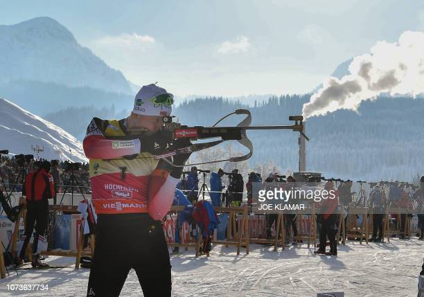 TOPSHOT Norway's Johannes Thingnes Boe takes a practice shot as he competes in the men's 125 km pursuit event of the IBU Biathlon World Cup in...