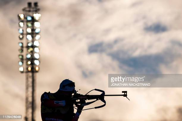 Norway's Johannes Thingnes Boe warms up at the shooting range before the Men's sprint event at the IBU Biathlon World Championships in Ostersund,...