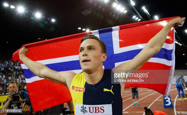 Norway's Karsten Warholm celebrates after winning in the Men 400m Hurdles during the IAAF Diamond League competition on August 29 in Zurich.