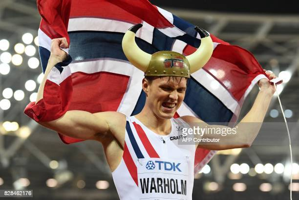 Norway's Karsten Warholm celebrates after winning the final of the men's 400m hurdles athletics event at the 2017 IAAF World Championships at the...