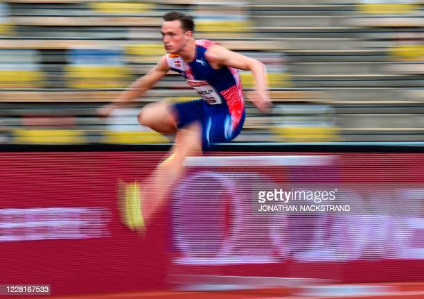 Norway's Karsten Warholm competes in the men 400m hurdles event during the Diamond League Athletics Meeting at Stockholm stadium on August 23, 2020.