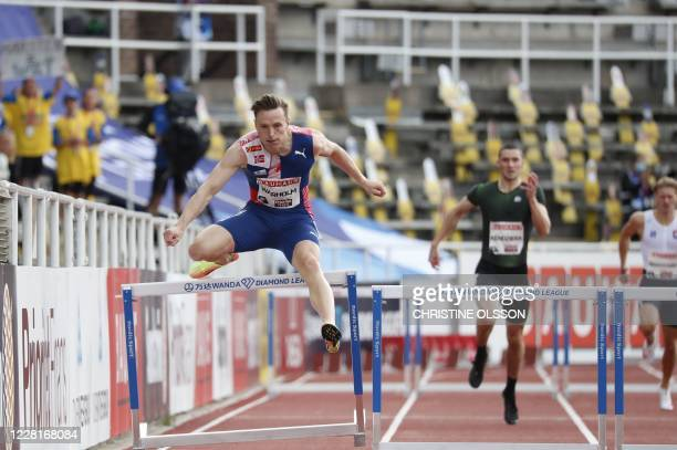 Norway's Karsten Warholm competes to win in the men 400m hurdles event during the Diamond League Athletics Meeting at Stockholm stadium on August 23,...