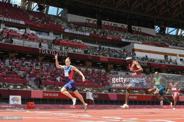 Norway's Karsten Warholm crosses the finish line to win and break the world record ahead of second-placed USA's Rai Benjamin and third-placed...