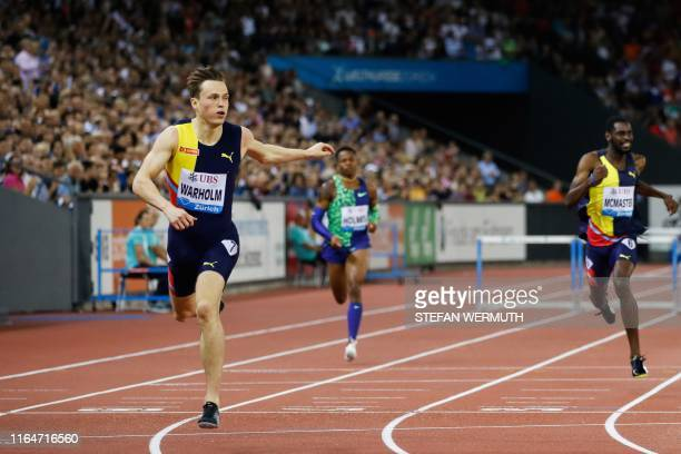 Norway's Karsten Warholm reacts as he crosses the finish line and wins the Men 400m Hurdles during the IAAF Diamond League competition on August 29...