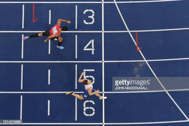 Norway's Karsten Warholm wins the men's 400m Hurdles final race ahead of Turkey's Yasmani Copello during the European Athletics Championships at the...