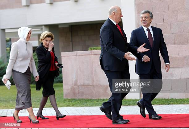 Norway's King Harald of Norway speaks with Turkish President Abdullah Gul during a welcoming ceremony at the Presidential Palace in Ankara on...