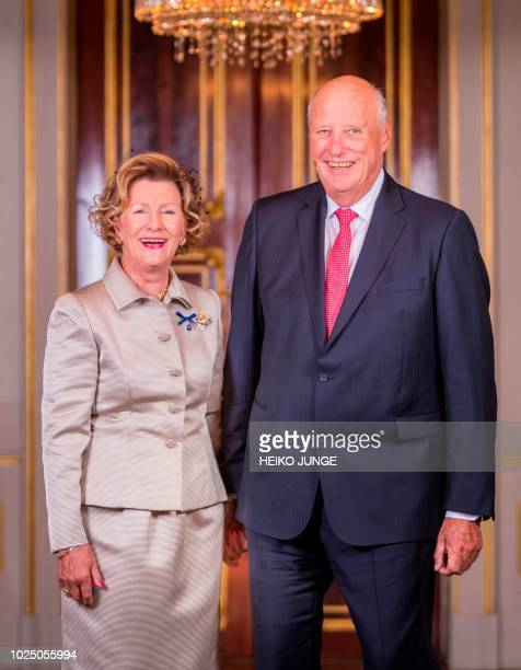 Norway's King Harald V and Queen Sonja pose for a photo at the Royal Palace as they celebrate their golden wedding anniversary in Oslo Norway on...