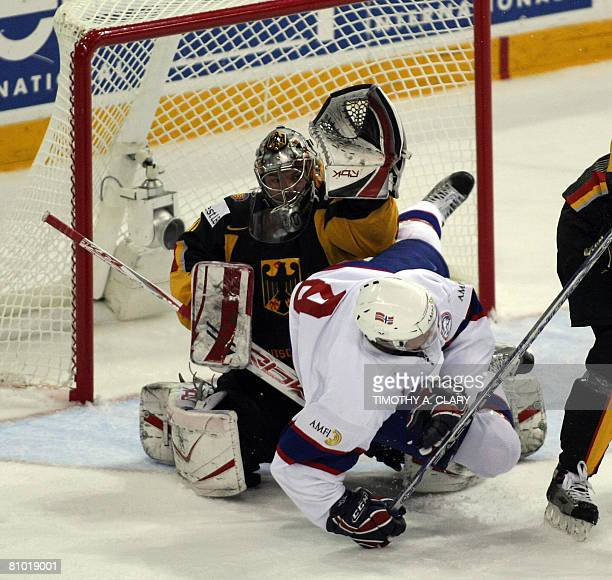 Norway's Kjell Richard Nygard and Germany's goaltender Robert Muller fight for the puck during the preliminary round of the 2008 IIHF World Hockey...