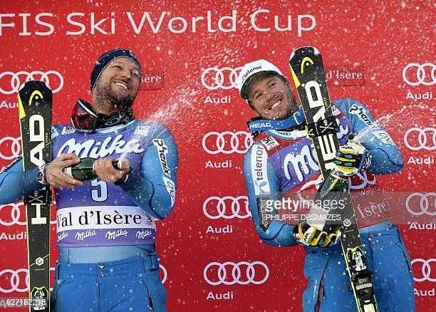 Norway's Kjetil Jansrud first and Norway's Aksel Lund Svindal second spray champagne during the podium ceremony of the FIS Alpine World Cup Men Super...