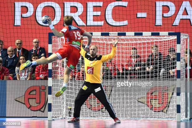 Norway's Kristian Bjornsen jumps to shoot the ball on goal in front of France's goalkeeper Vincent Gerrad during the preliminary round group B match...