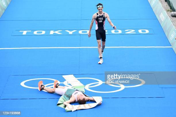 Norway's Kristian Blummenfelt celebrates finishing first to win gold as second placed Britain's Alex Yee reacts at the end of the men's individual...