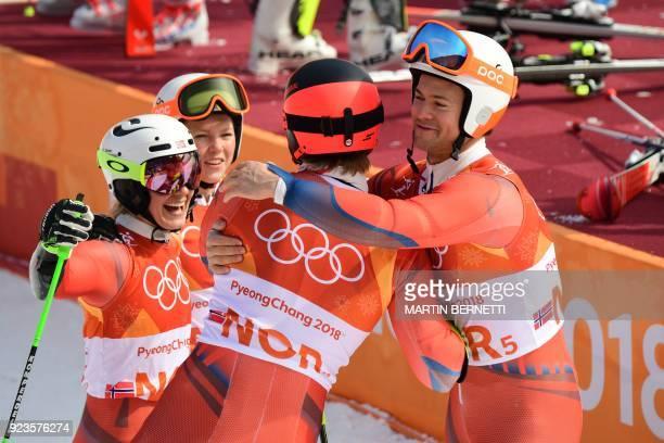 Norway's Kristin Lysdahl Norway's Sebastian FossSolevaag Norway's Nina HaverLoeseth and Norway's Leif Kristian NestvoldHaugen celebrate after winning...