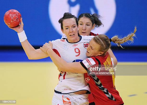 Norway's Kristine LundeBorgersen vies for the ball with Montenegro's Andrea Klikovac and Milena Knezevic during the 2012 EHF European Women's...