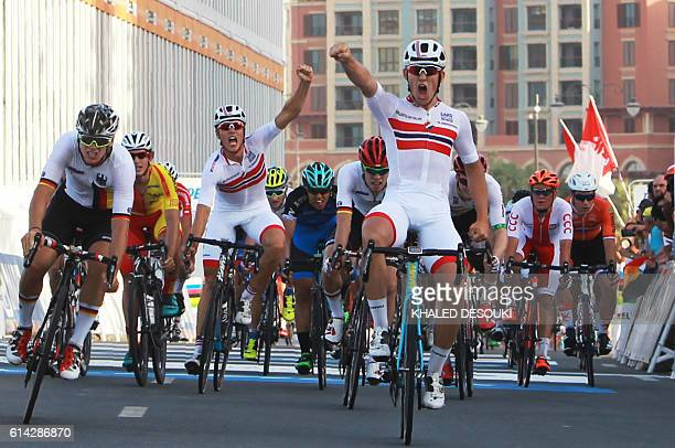 Norway's Kristoffer Halvorsen celebrates after winning the men's under 23 road race event as part of the 2016 UCI Road World Championships on October...