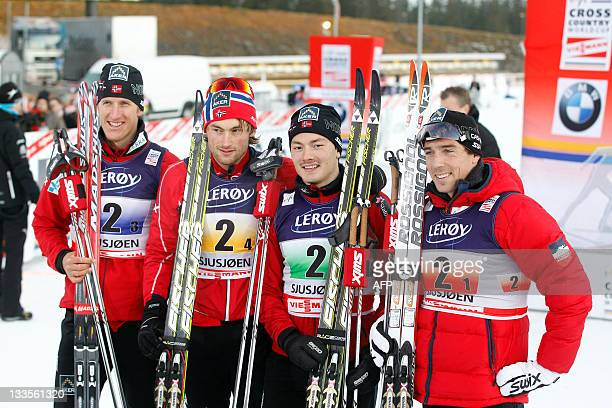 Norway's Lars Berger Petter Northug Finn Haagen Krogh and Eldar Ronning pose after wining the men's Nordic Skiing World Cup 4x10 km relay in Sjusjoen...
