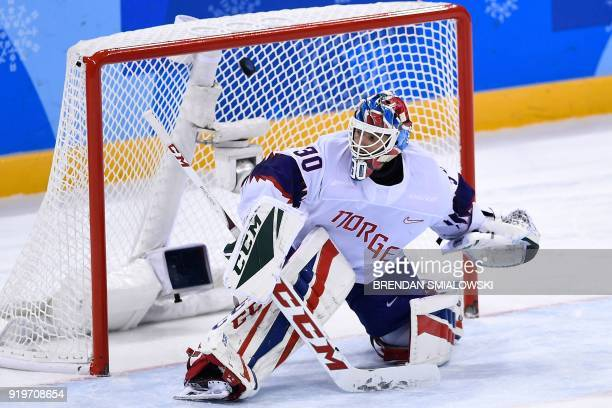 TOPSHOT Norway's Lars Haugen concedes a goal during overtime in the men's preliminary round ice hockey match between Germany and Norway during the...