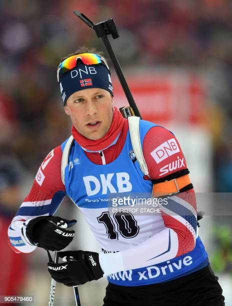Norway's Lars Helge Birkeland arrives for the warmup shooting prior the men's 15 kilometer mass start competition at the Biathlon World Cup on...