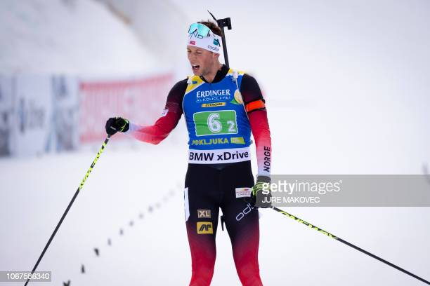 Norway's Lars Helge Birkeland reacts on the finish line as he wins the Single Mixed Relay competition of the IBU Biathlon World Cup in Pokljuka on...