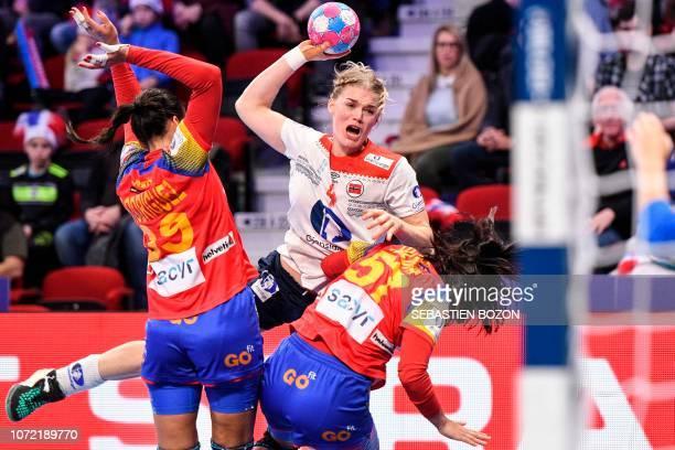 Norway's left back Veronica Egebakken Kristiansen vies with Spain's right back Almudena Rodriguez and Spain's right wing Paula Maria Valdivia...