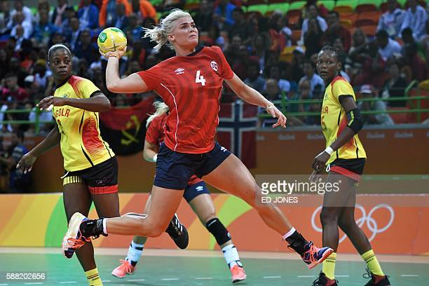Norway's left back Veronica Kristiansen jumps to shoot during the women's preliminaries Group A handball match Norway vs Angola for the Rio 2016...