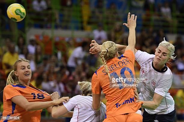 Norway's left back Veronica Kristiansen shoots past Netherlands' left back Kelly Dulfer and Netherlands' pivot Danick Snelder during the women's...