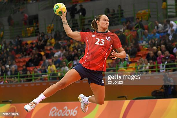 Norway's left wing Camilla Herrem jumps to shoot during the women's preliminaries Group A handball match Norway vs Angola for the Rio 2016 Olympics...