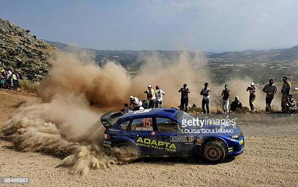 Norway's Mads Ostberg and Jonas Andersson of Sweden drive their Subaru Impreza at KleniaMycenae on day two of the WRC Rally Acropolis near the...