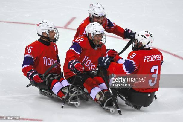 Norway's Magnus Bogle celebrates a goal with teammates against Japan during the ice hockey classification game between Norway and Japan at the...