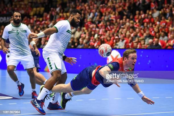 Norway's Magnus Gullerud vies with Saudi Arabia's Adnan Radnah during the IHF Men's World Championship 2019 Group C handball match between Norway and...