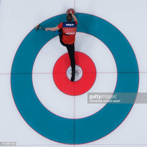 TOPSHOT Norway's Magnus Nedregotten slides the stone during the curling mixed doubles round robin session between Norway and Finland during the...