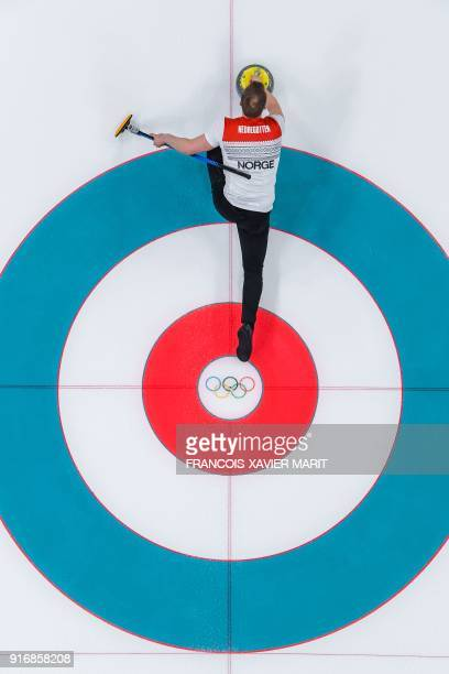 Norway's Magnus Nedregotten throws the stone during the curling mixed doubles round robin session between Norway and China during the Pyeongchang...