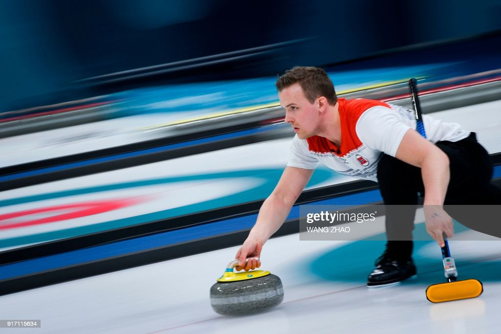 TOPSHOT - Norway's Magnus Nedregotten throws the stone during the curling mixed doubles tie-breaker game during the Pyeongchang 2018 Winter Olympic Games at the Gangneung Curling Centre in Gangneung on February 11, 2018. / AFP PHOTO / WANG Zhao