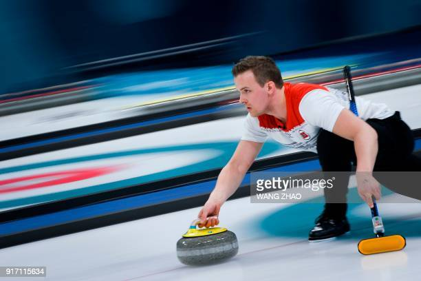 TOPSHOT Norway's Magnus Nedregotten throws the stone during the curling mixed doubles tiebreaker game during the Pyeongchang 2018 Winter Olympic...