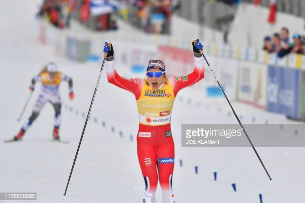Norway's Maiken Caspersen Falla celebrates after winning the final sprint of the Ladies' cross-country event at the FIS Nordic World Ski...