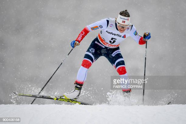 Norway's Maiken Caspersen Falla competes in the Women's 15 km Sprint Free qualification during the cross country FIS World cup Tour de Ski event on...
