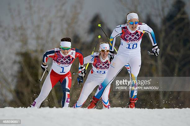 Norway's Maiken Caspersen Falla France's Aurore Jean and Sweden's Stina Nilsson compete in the Women's CrossCountry Skiing Individual Sprint Free...