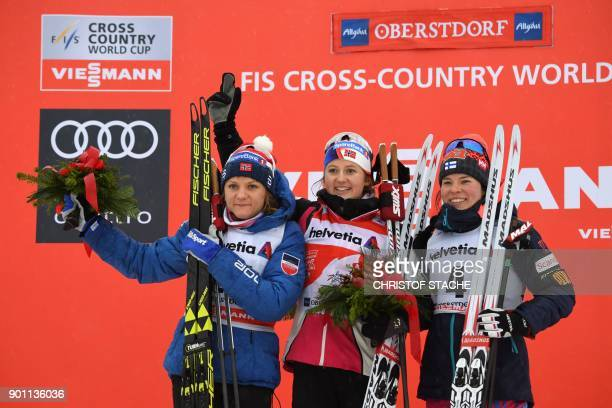 Norway's Maiken Caspersen Falla her compatriot Ingvild Flugstad Oestberg and Finn Krista Parmakoski celebrate on the podium during the winner...
