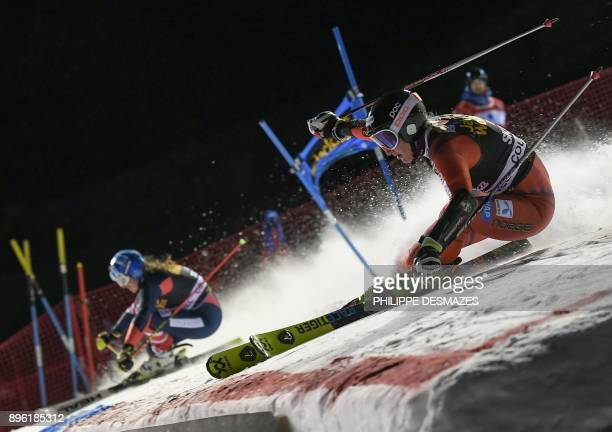Norway's Maren Skjoeld and US Alex Tilley compete during the FIS Alpine World Cup Women's Parallel Slalom on December 20 2017 in Courchevel French...
