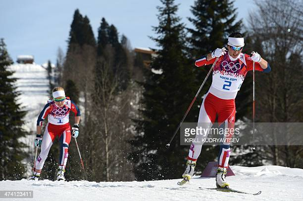 Norway's Marit Bjoergen and Norway's Therese Johaug compete in the Women's CrossCountry Skiing 30km Mass Start Free at the Laura CrossCountry Ski and...