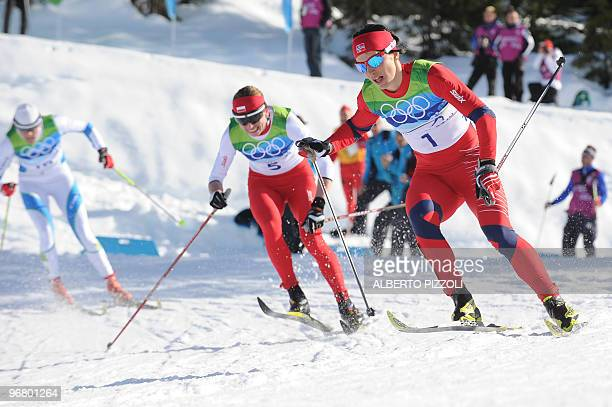Norway's Marit Bjoergen and Poland's Justyna Kowalczyk compete in the women's Nordic Cross Country individual sprint final at Whistler Olympic Park...