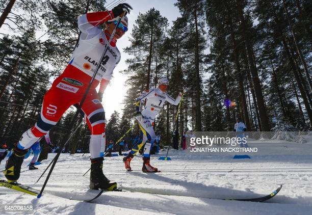 Norway's Marit Bjoergen and Sweden's Charlotte Kalla compete during the women's Skiathlon event of the 2017 FIS Nordic World Ski Championships in...
