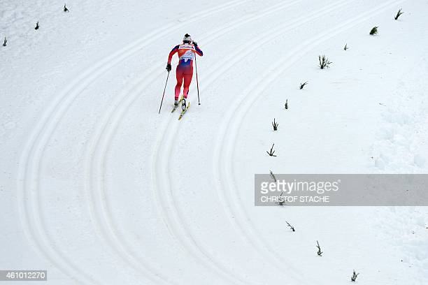 Norway's Marit Bjoergen competes during the 10 kilometers pursuit classic style women's competition of the Tour de Ski Cross Country World Cup on...