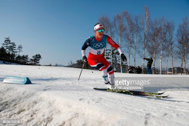 TOPSHOT Norway's Marit Bjoergen competes during the women's 30km cross country mass start classic at the Alpensia cross country ski centre during the...