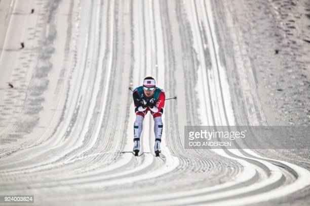 Norway's Marit Bjoergen competes during the women's 30km cross country mass start classic at the Alpensia cross country ski centre during the...