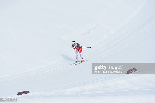 Norway's Marit Bjoergen competes in the Men's CrossCountry Skiing Team Sprint Classic Final at the Laura CrossCountry Ski and Biathlon Center during...