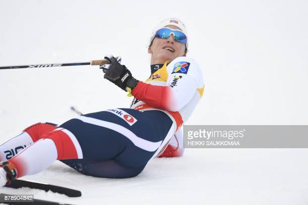 Norway's Marit Bjoergen lies on the snow after she won the Ladies' cross country skiing 10km classic style competition at the FIS World Cup Ruka...