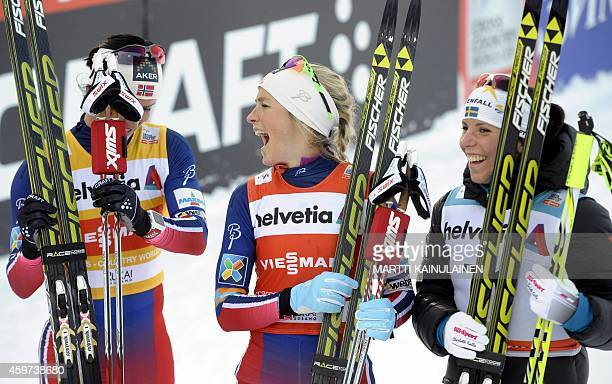 Norway's Marit Bjoergen Norway's Therese Johaug and Sweden's Charlotte Kalla celebrate after the women's cross country 10 km classic style skiing...