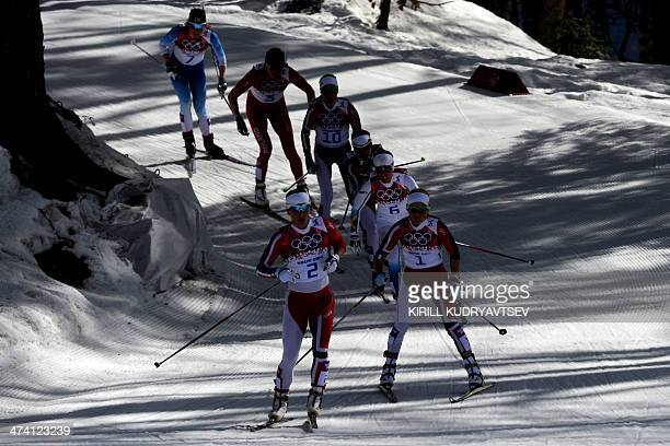 Norway's Marit Bjoergen Norway's Therese Johaug Sweden's Charlotte Kalla and Norway's Heidi Weng compete in the Women's CrossCountry Skiing 30km Mass...
