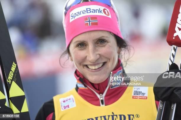 Norway's Marit Bjoergen poses after she won the Ladies' cross country skiing 10km classic style competition at the FIS World Cup Ruka Nordic 2017 in...