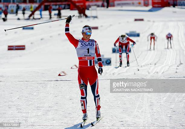 Norway's Marit Bjoergen reacts after crossing the finish line to win the FIS CrossCountry World Cup Ladies 10 km Classic Mass Start in Falun Sweden...